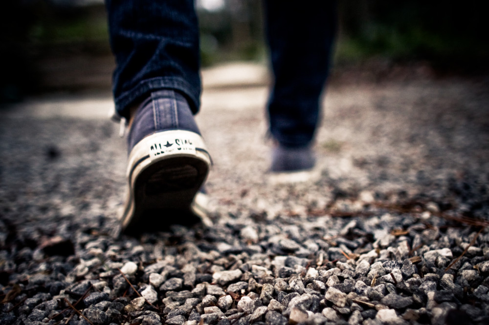 shoes-walking-feet-grey-gravel--1000x666